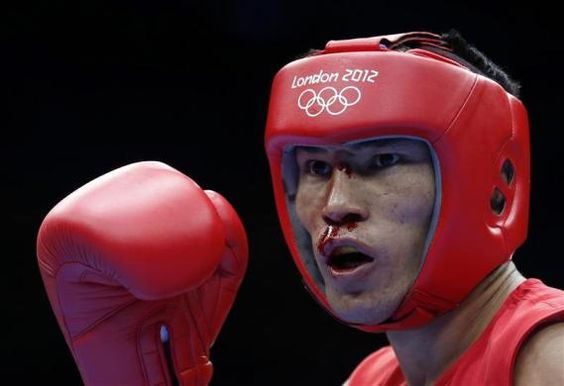 Kazakhstan's Gani Zhailauov fights against Thailand's Saylom Ardee during the men's light (60kg) Round of 32 boxing match at ExCeL venue during the London 2012 Olympic Games July 29, 2012.