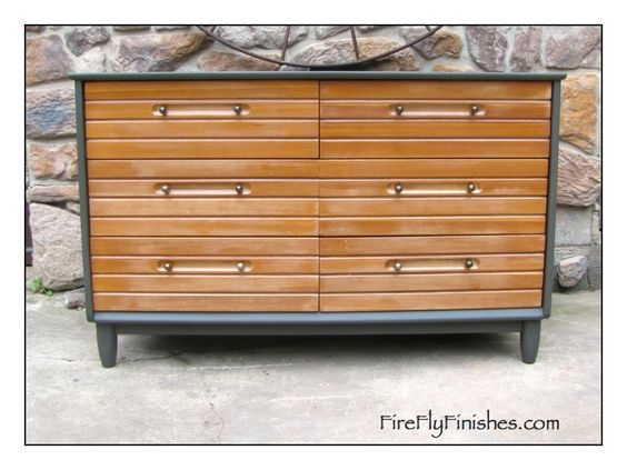 Benjamin Moore Dragon's Breath frame makes the wood on this mid century dresser pop.