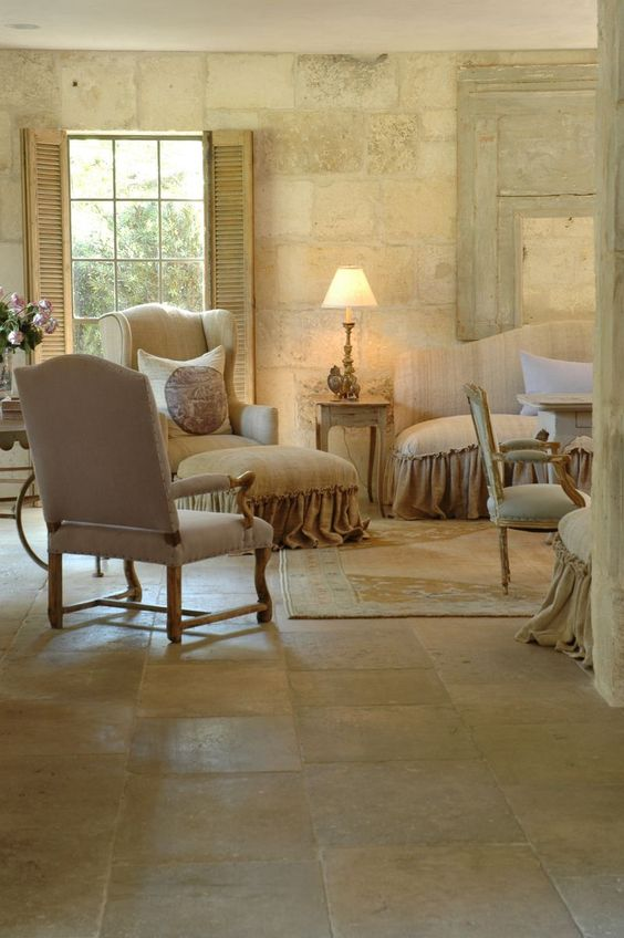 Elegant and understated French Country home with stone walls and flooring. Ruth Gay's home via Velvet and Linen