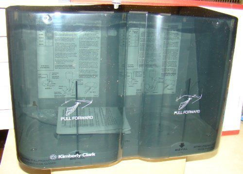 """Kimberly-Clark Center flow wiper Dispenser by In Sight. $12.99. 10.5"""" x 15"""" x 8"""". Suggested mounting height 52"""". One hand use helps eliminate spread of germs. Ziederzee will ship this within hours.. High-Impact smoke grey plastic back and transparent cover. Center flow dispenser holds two rolls of 250 towels. No touch dispensing helps reduce spread of germs and dirt. No moving parts. One per case. Suggested mounting height 52"""""""