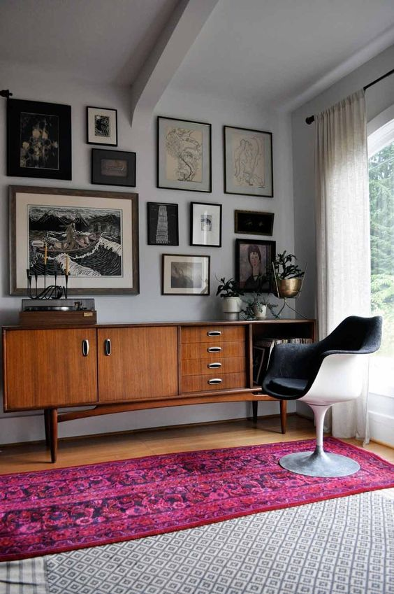 Updated Style: Mid-Century Modern   credenza and gallery wall / pink oriental runner / tulip chair