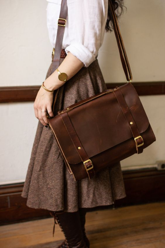 """The Debussy is a durable and stylish satchel for men with good taste. Sustainably and locally made with Horween leather and solid brass hardware, perfect for work or a weekend away. Adjustable strap. Size: Approximately 14 1/2"""" (length) x 5 1/2"""" (width) x 9 1/2"""" (height) We care about quality and we're passionate about American craftsmanship. That's why we purchase our hand-dyed and tanned leather from Horween, one of the oldest family-owned tanneries in America. Solid brass hardware and rivet"""