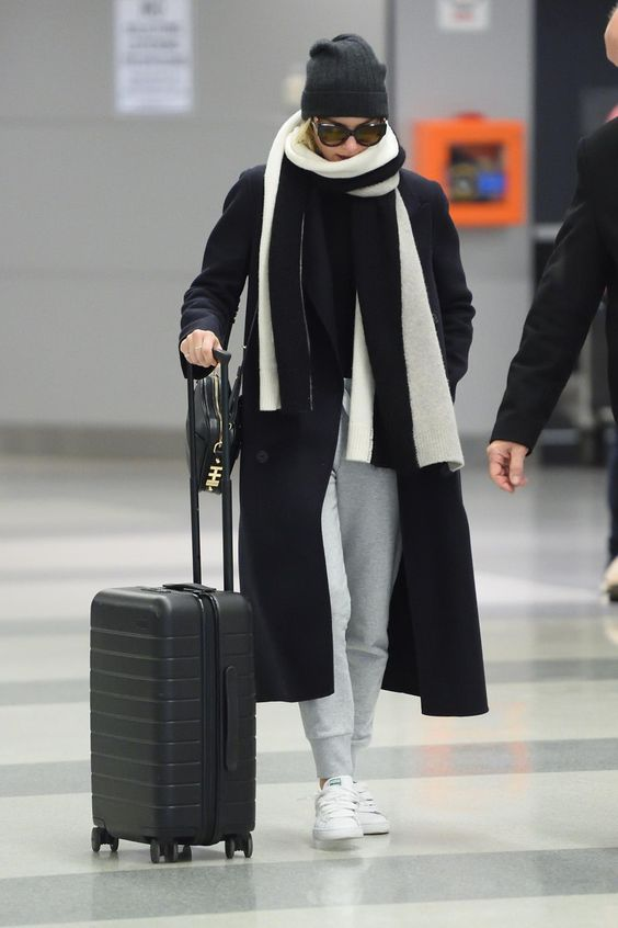 Margot Robbie wearing Away Carry-on Suitcase, Puma Basket Classic Sneakers, Burberry Felted Wool Double-Breasted Coat and Dylan Kain the Rodriguez Gunmetal Bag