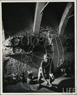 For this 1949 portrait of Pablo Picasso in his studio in the south of France, the artist was inspired by Gjon Mili's previous photos of ice skaters spinning through the air with small lights attached to their skates. Mili left the shutters of his cameras open as Picasso made ephemeral drawings in the air of a darkened room. This one was of one of a centaur. Mili caught the artist himself by using a 1/10,000th-second strobe light. This photo actually captures the moment of creation by a…