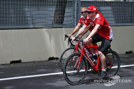Kimi Raikkonen, Ferrari rides the circuit with Mark Arnall, Personal Trainer