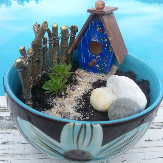 My first fairy garden made by : https://www.facebook.com/Sissismykker
