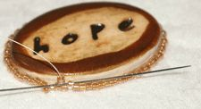 How to bezel a cabochon with peyote stitch for bead embroidery. Free beading instructions for making a peyote stitch beaded bezel from Beading Daily!  http://www.beadingdaily.com
