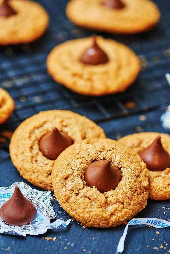 These flourless peanut butter blossoms are perfect if you need to whip up a quick dessert. Perfect for your gluten-free, dairy-free friends, and perfect if you just want a really delicious, super peanut buttery, chewy, melted chocolatey cookie. showmetheyummy.com #glutenfree #dairyfree #cookies #peanutbutterblossoms #holiday #christmas #dessert #peanutbutter #candy