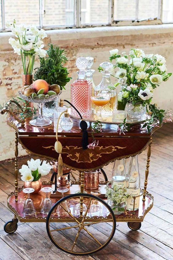 """Vintage Drinks Trolley: To hire (includes all glassware, floral arrangements and fruit bowl), £1,250, and apricot and sweet cicely Champagne cocktail, from £7.50, gingarden.com [link url=""""/planning/receptions/reception-themes/2017/01/wedding-trends-2017/gallery#!photo1""""]THE BIGGEST WEDDING TRENDS FOR 2017[/link] [link url=""""/planning/receptions/reception-themes""""]MORE BEAUTIFUL RECEPTION THEMES[/link]"""