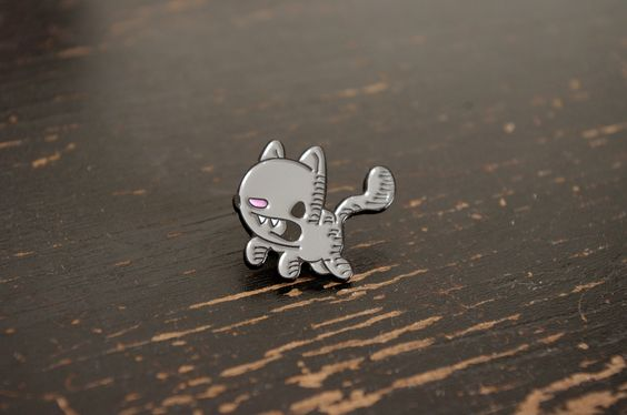 "this cute enamel pin is certain to brighten up your bag or jacket. it is approximately 1"" in size and comes with a screen printed cardboard backer. buy two and pass one on to another cat lover in your"