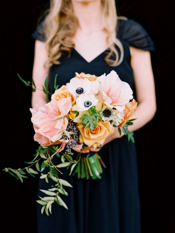 Dark Blue bridesmaid with shades of peach + gold yellow wedding bouquet with anemones - photo by Adam Barnes