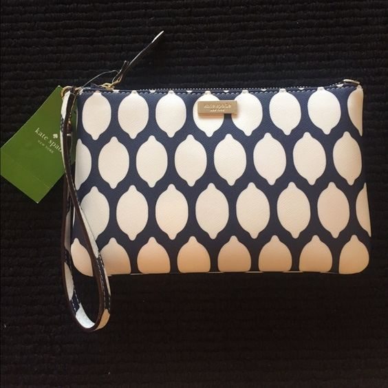 "KateSpade Navy Lemons Wristlet Lolly Grant Street Grainy Vinyl. 14 K Gold Plated Hardware. 4 Credit Card Slots, Top Zip Closure. Dog leash clip handle can be used to clip at opposite end of bag.                        Dimensions About 7.7 L x 5 H x 0.5 D"" kate spade Bags Clutches & Wristlets"