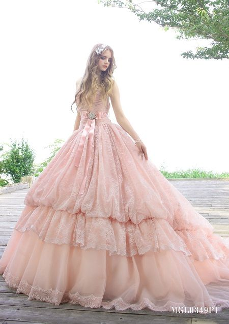 dball -kinda fairytale-ish...makes this model look super tall maybe a little too flouncy for me. wish I could see the neckline better...like the sash around waist: