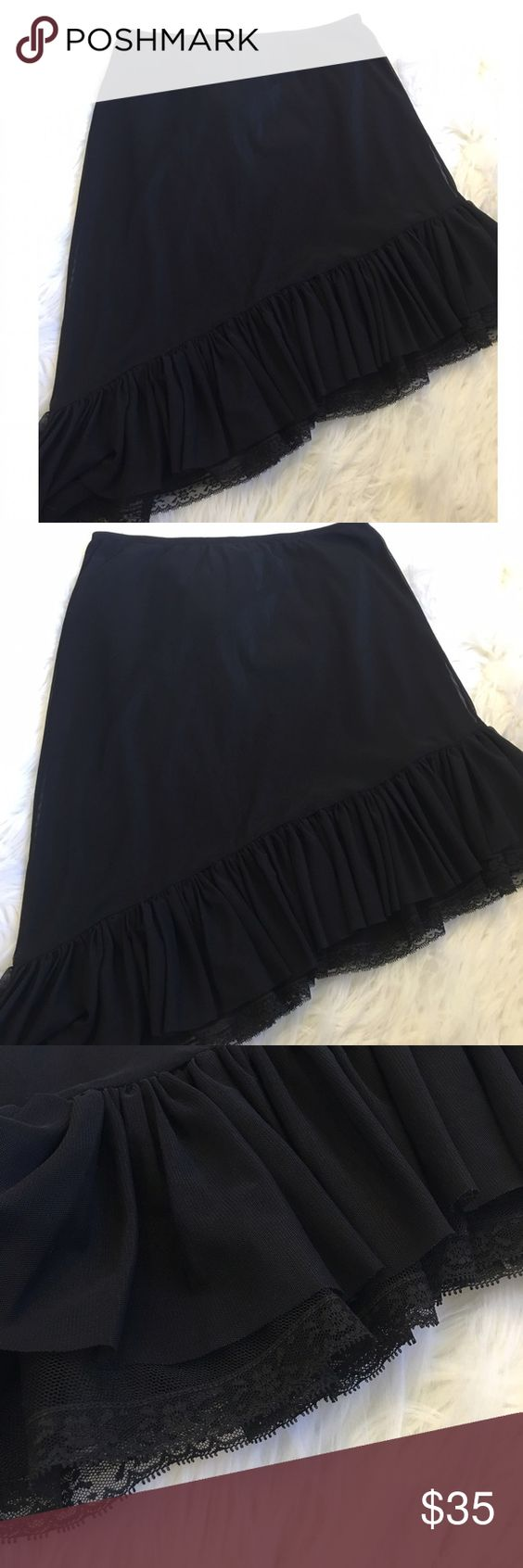 "✨BETSY JOHNSON ASYMETRICAL SKIRT✨ Betsy Johnson black ASYMETRICAL skirt. Elastic waist. Ruffle lace detail along bottom. Fits size xsmall to small. Laying flat waist measures 12"". ( but elastic stretches to 27"").  From top of waist to bottom of longest point of skirt measures 24"". Shortest point is 16"". Excellent condition Betsey Johnson Skirts Asymmetrical"