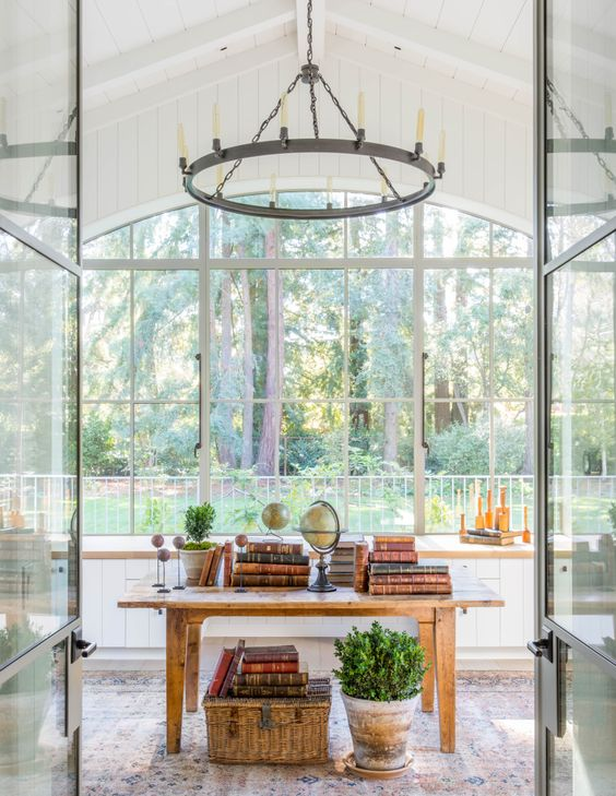 Seen through the monumental steel window (all steel windows and doors by Euroline) in Annie and Jim's office, the redwoods make quite a spectacular view that can be enjoyed even when the glass steel interior doors are closed. Giannetti_Atherton