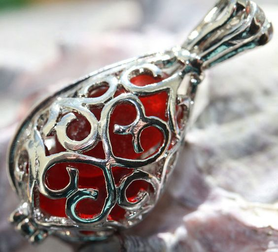 Red sea glass filled locket.