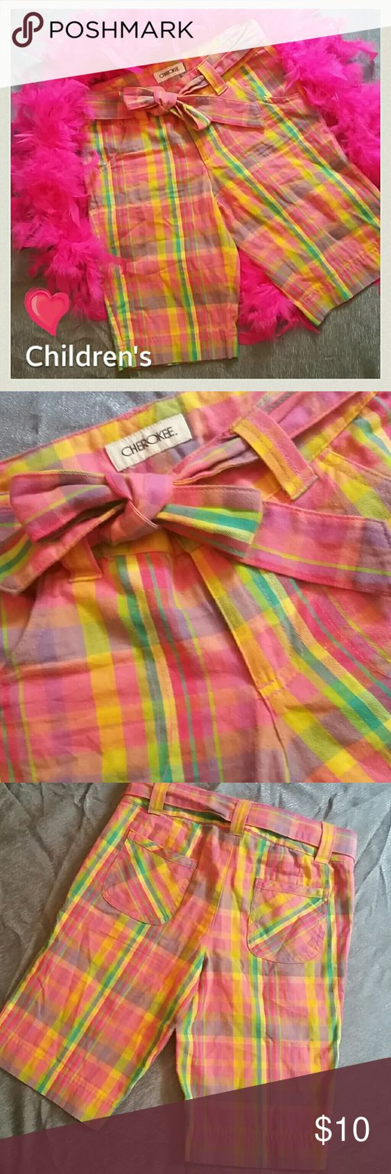 """Kids! Cherokee Bright Plaid Shorts W/ Belt These have been gently pre-loved a few times only. Great condition. And those colors pop! So cute! There are no rips, tears, etc. There is a tiny patch of minor pilling in the upper Thigh area. In between the legs. So unnoticeable! Can be easily removed if bothersome. REMOVABLE BELT. Elastic buttons inside for better fit and to accommodate growth. Adjustable.  Enjoy! Inseam 10"""" Rise 8"""" Waist Circ 24"""" Cherokee Bottoms Shorts"""