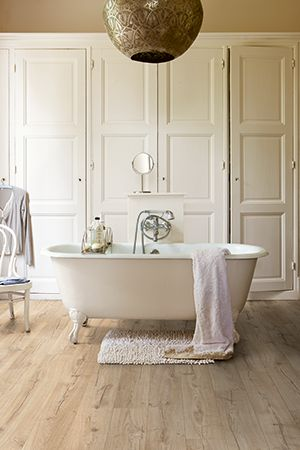 Quick-Step Impressive waterproof laminate flooring in bathroom