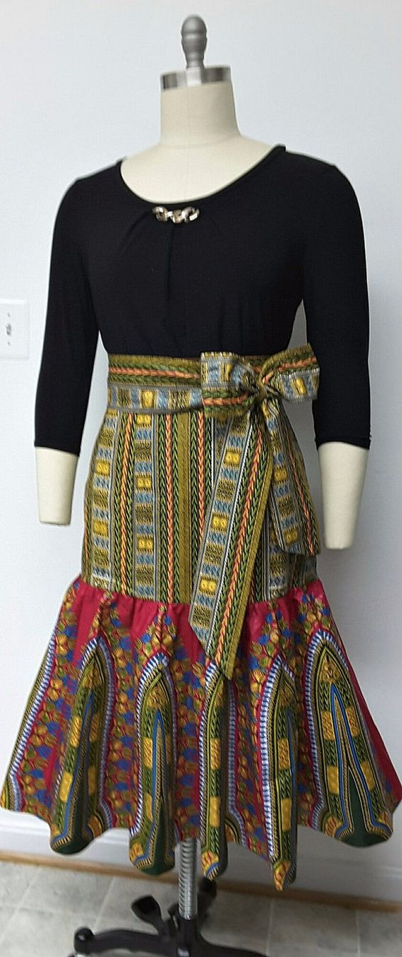 African Print Fitted Hip Midi Skirt. Sash Waistband. Womens Clothing. Handmade Clothing. African Print Skirt. This skirt is fitted at the hip, attached to a fully gathered bottom, and fully lined. The finished length of Skirt is 28 inches. Ankara | Dutch wax | Kente | Kitenge | Dashiki | African print dress | African fashion | African women dresses | African prints | Nigerian style | Ghanaian fashion | Senegal fashion | Kenya fashion | Nigerian fashion | Ankara crop top (affiliate)
