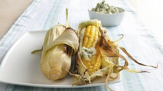 Grill corn in the husks for tender, sweet corn made even better with a dollop of fresh herb butter!
