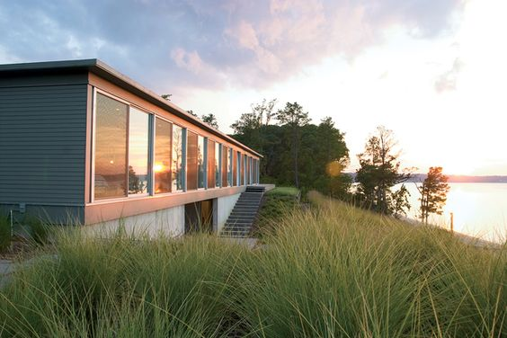 """Ziger/Snead Architects constructed this ode to rowing in rural Virginia for a Baltimore couple who share a love of sculling. """"Everywhere in the house you can see the moment where land meets water,"""" says Douglas Bothner, an associate at the firm.    Read more: http://www.dwell.com/slideshows/homes-with-a-waterfront-view.html?slide=3=y=true##ixzz267669RKB"""