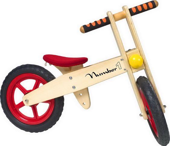 """Laufrad """"Number 1"""". Spielend die Straße erobern ist mit dem aus Holz verarbeiteten Laufrad von 2,85 kg für junge Rennfahrer kein Problem. Zudem wird das Gleichgewicht geschult und durch die robusten Gummireifen und die verstellbare Höhe auch die Vorfreude auf das Fahrradfahren gestärkt."""
