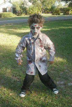 To make an easy zombie costume, just put come red paint on a ripped white shirt and add some dark eye make-up.