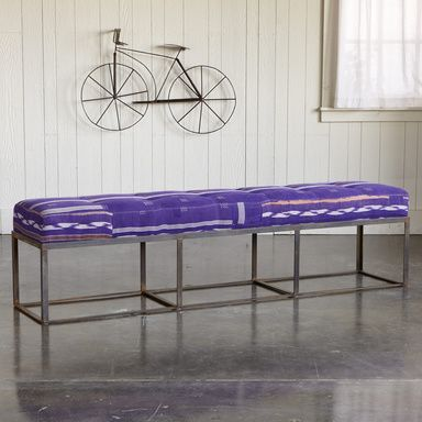SHANTI VINTAGE SARI BENCH�--�At the table, in an entry, at the foot of the bed, this lightly tufted bench upholstered with a hand-stitched vintage sari stands out. Foam cushion, maple wood frame and sturdy forged metal base. Each bench is one of a kind. Imported. 72W x 18D x 16H.