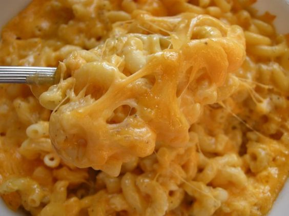 1 can creamed corn, 1 can sweet corn, 1 stick light margarine, 1 cup elbow macaroni, 1 cup velveeta. Don't drain any cans. Add salt and pepper to taste. Cook in crockpot until noodles are done. AMAZING!!