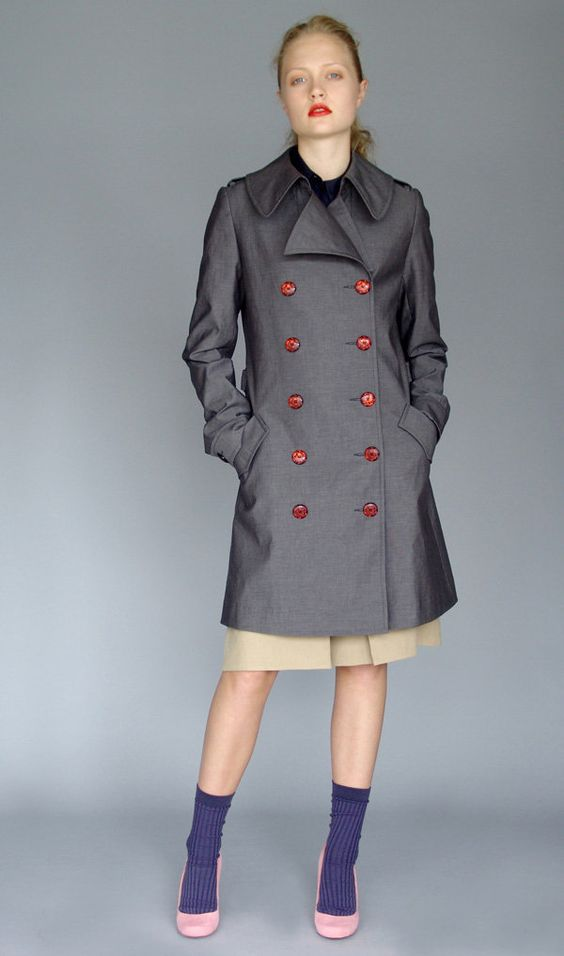 grey coat red buttons. I like her style.