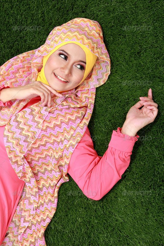 Young muslim girl lying on grass - Stock Photo - Images