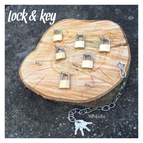Lock and key busy board with padlocks. DIY project
