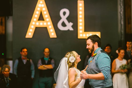 My dad made these Marquee Letters with our initials. They were one of my favorite parts of the decor for our reception. they made a bold statement when you walked through the door. Boho Rustic Eclectic Wedding PC Shannon Lee Miller