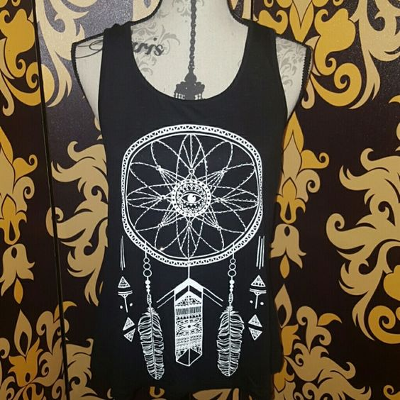 Studded dream catcher tank BNWT studded dreamcatcher tank Kama Razorback. Black and white and color 96% rayon 4% spandex machine wash with cold water hang to dry. 18 and a half inches long from the front 22 and a half inches long from the back Tops Tank Tops