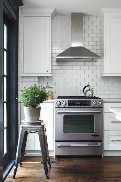 stainless steel range hood with white subway tile backsplash tile i like pinterest stove. Black Bedroom Furniture Sets. Home Design Ideas