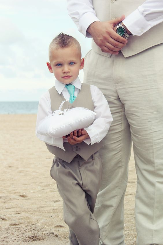 Ring Bearer in matching color pants and vest and tie color as groom