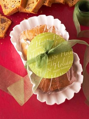 Cute way to wrap food for gifts.  Bread is in a coffee filter, plastic wrapped with a ribbon and matching label.