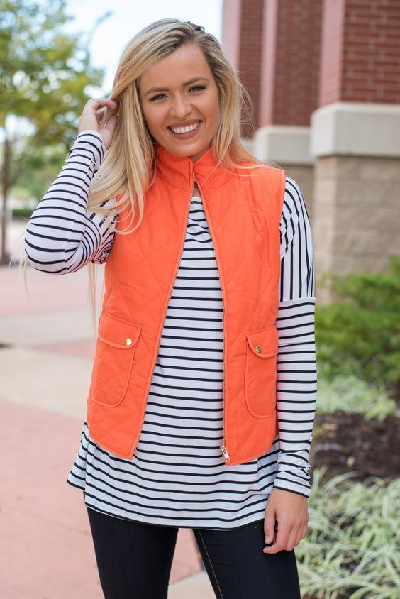 Solid quilted lightweight puffer vest orange. A best selling quilted puffer vest…