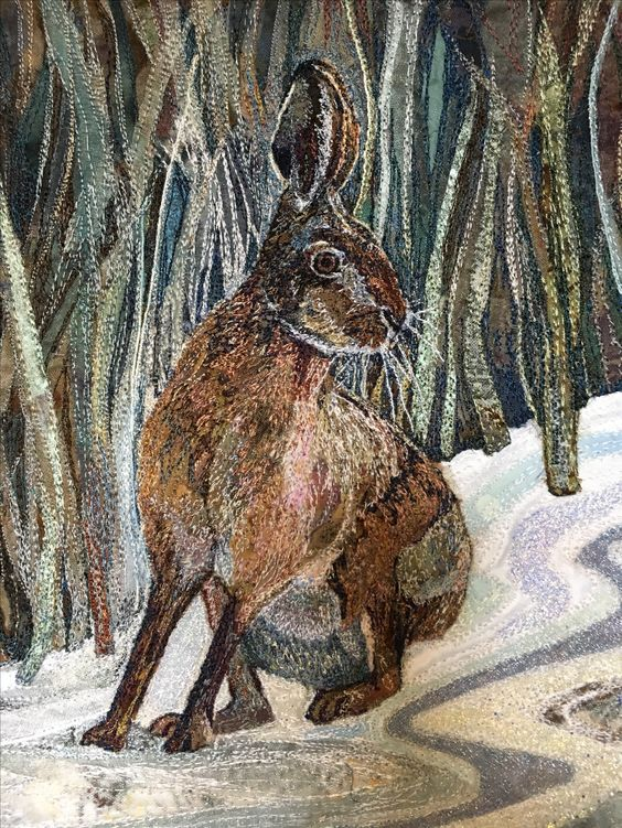 Machine embroidered hare in the snow by Rachel Wright. Pieced fabrics on calico with Rayon threads.: