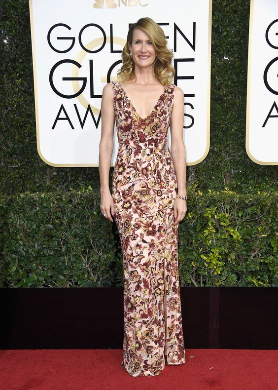 Golden Globe presenter Laura Dern wearing a Burberry pink heather hand-embroidered floral custom gown on the red carpet in Los Angeles