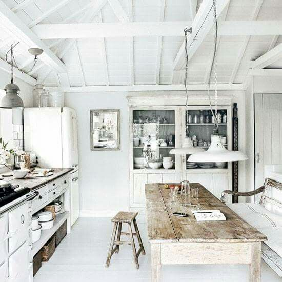 Rustic white kitchen with farm table and barn style pendants. #kitchen #europeancountry #whitedecor #rustic