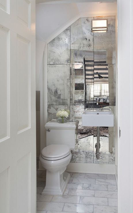 Ty Larkins Interiors - bathrooms - small powder room, powder rooms, antiqued mirror, mirrored wall, antiqued mirrored wall, wall mounted sin...::