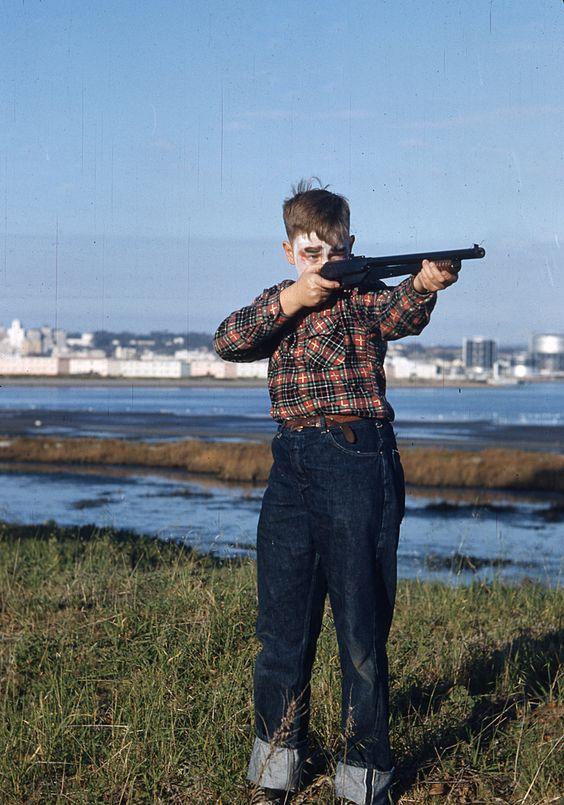 Boy in Clown Makeup with a Gun. Photo taken circa 1950