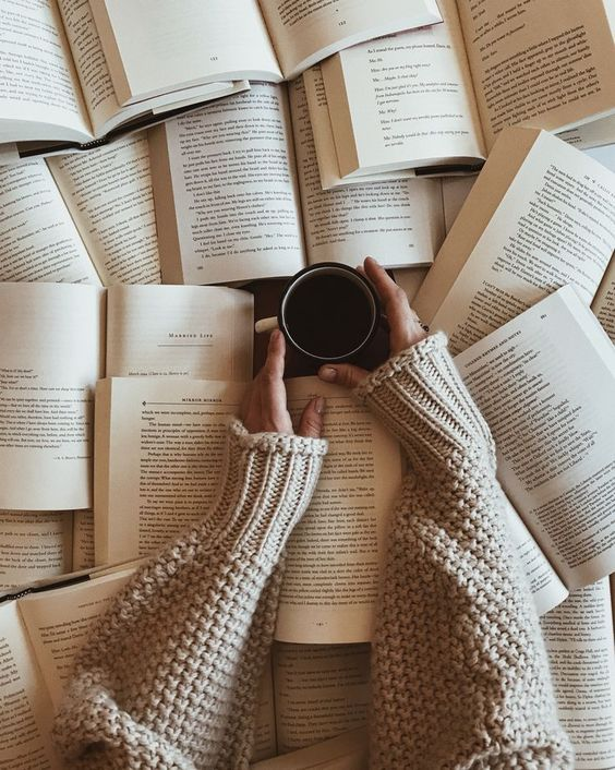 Pile of books with coffee and cozy scarf #bookish #photography #booklover #bookworm