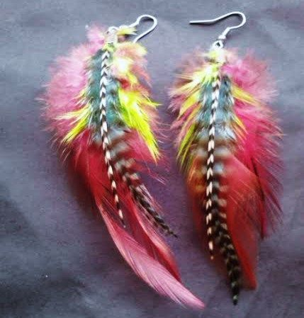 Brightly colored hand dyed feathers in neon and black stripes for a retro look! These earrings are really fun, comfortable and light to wear.  They measure about 4 inches in length and have a nice width so they will definitely stand out.  The great price combined with free worldwide shipping makes these a great secret santa or stocking stuffer idea!