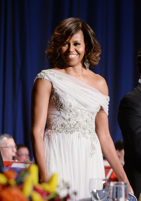 While attending the 100th Annual White House Correspondents' Dinner, Michelle gave us one for the ages with her romantic one-shoulder Marchesa gown.