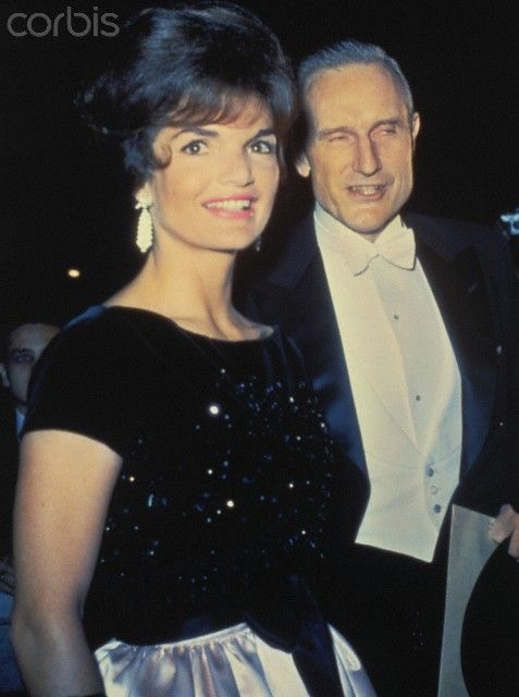 Mrs. John F. Kennedy with John D. Rockefeller III, arrives at the opening of the New York Philharmonic at Lincoln Center.