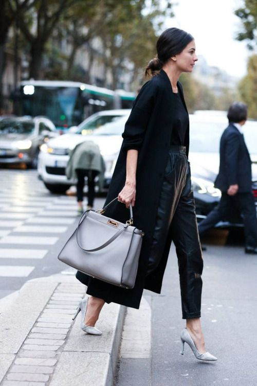 A long black cardigan, black t-shirt, leather culottes, Fendi Peekaboo tote and grey suede pumps. Shop the street style look...: