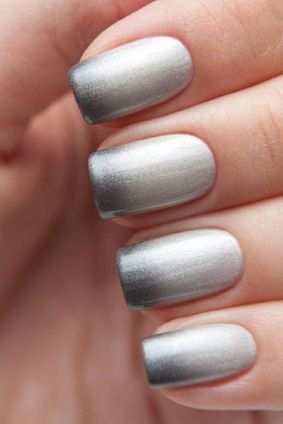 Silver and white Ombre nail art design. If you want to go simple and classic then this nail art design fits you well. The glitter adds to the sophistication of the nails.