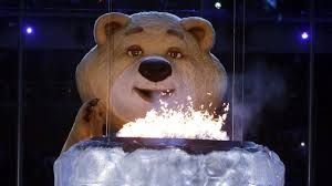A large bear mascot blows out the Olympic flame with his breath during the closing ceremony of the 2014 #Sochi #Olympic Games.